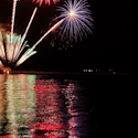 time lapse photography of fireworks in green, red, pink, orange, and purple